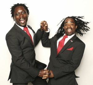 Darion and Brenton happily dancing in matching suits